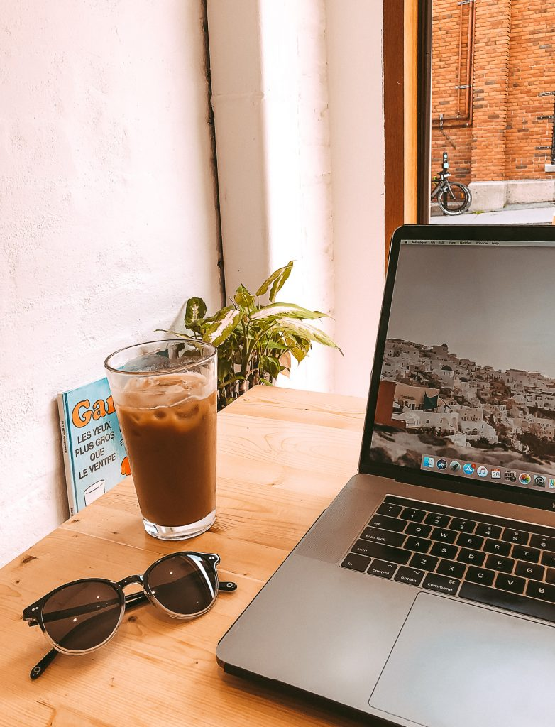 Digital nomad cafe laptop table scene